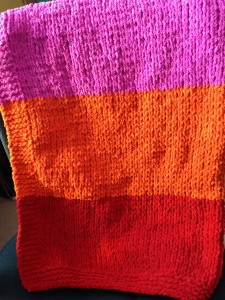 And a brightly coloured baby blanket