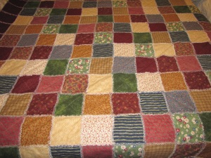 A full size rag quilt for our queen bed