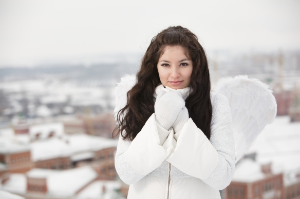Angel on the roof in cold winter